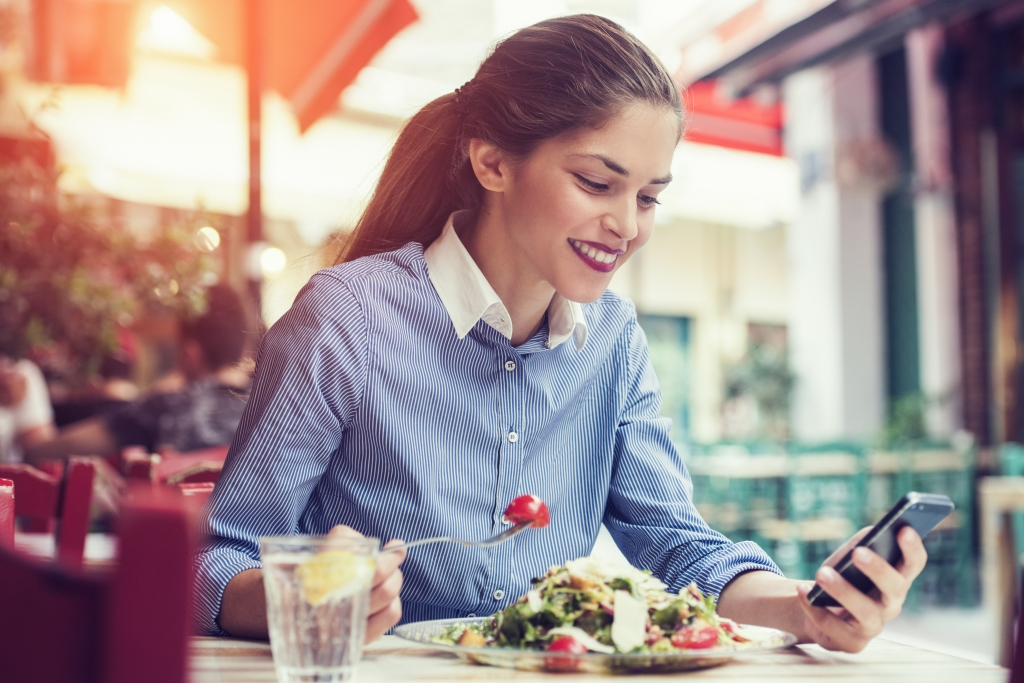 woman is eating at a restaurant
